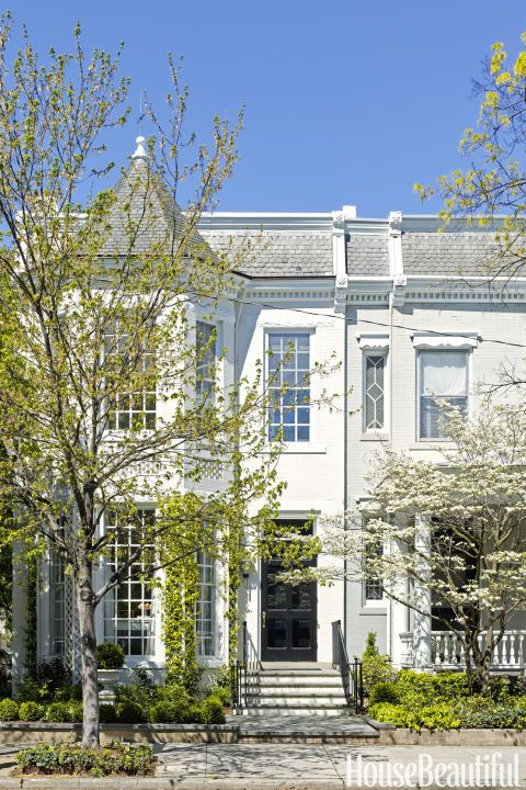 This 19th-century design is both beautiful and classic. Historic homes of a similar age surround this 1892 townhouse in Richmond, Virginia, but don't let its understated facade fool you — designer Suellen Gregory coated the interior in bold shades of pink. Click through for more home exteriors and house exterior design ideas.