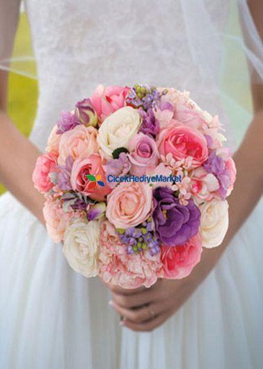 Renkli Güller Gelin Buketi pembe beyaz somon rengi güller ile mor lisyantus çiçekleri ile hazırlanmış çok özel düğün çiçeği ile gecenin yıldızı siz olun.