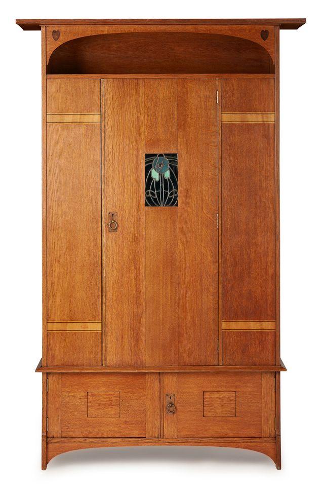ERNEST ARCHIBALD TAYLOR (1874-1951) FOR WYLIE & LOCHHEAD, GLASGOW OAK HALL CUPBOARD, CIRCA 1900