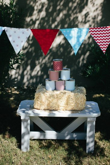 Isn't this just the cutest little display. Perfect for children's birthdays   DIY Can Toss at Vintage Country Fair First Birthday www.weheartparties.com