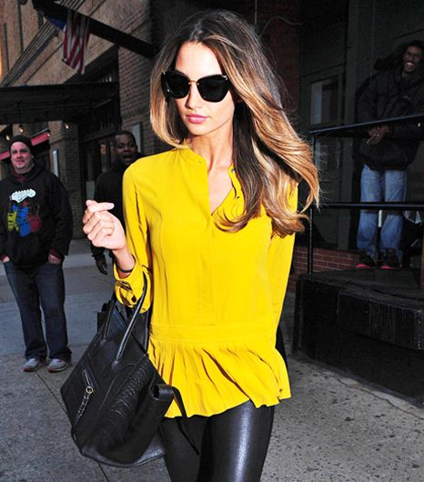 Lily Aldridge - yellow silk peplum top, leather pants, and oh! Those sunnies! Where do I get them?