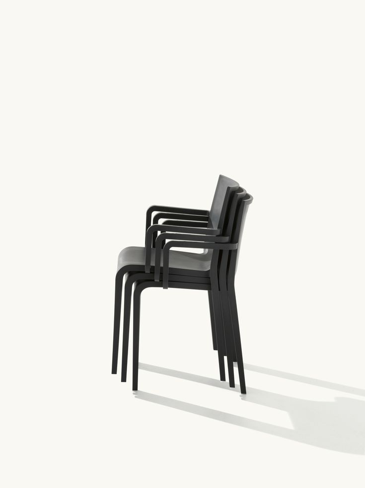 Nassau 2.0 in Black. Stacking chair made from air-molded polypropylene and designed by Marc Sadler for the Metalmobil collection.