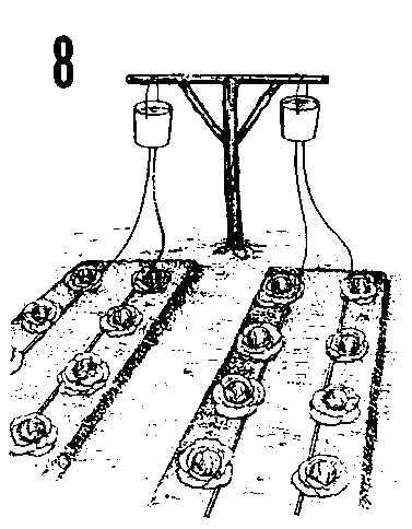 Bucket irrigation system. Could be hung on an old clothesline post. The article mentions filling the buckets with water, but I would use it as a rainwater collection system. Close the valve on rainy days then open it when the garden needs water.