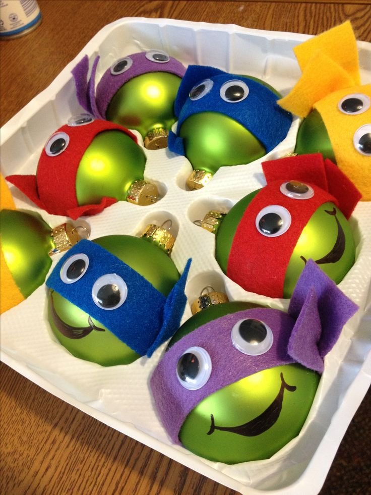 Teenage Mutant Ninja Turtle Christmas ornaments I made for a very special little boy =)   (I used glass ornaments even though I would've preferred plastic, felt cut in strips, googley eyes, and a black sharpie to draw the mouths. It was super simple and easy!)
