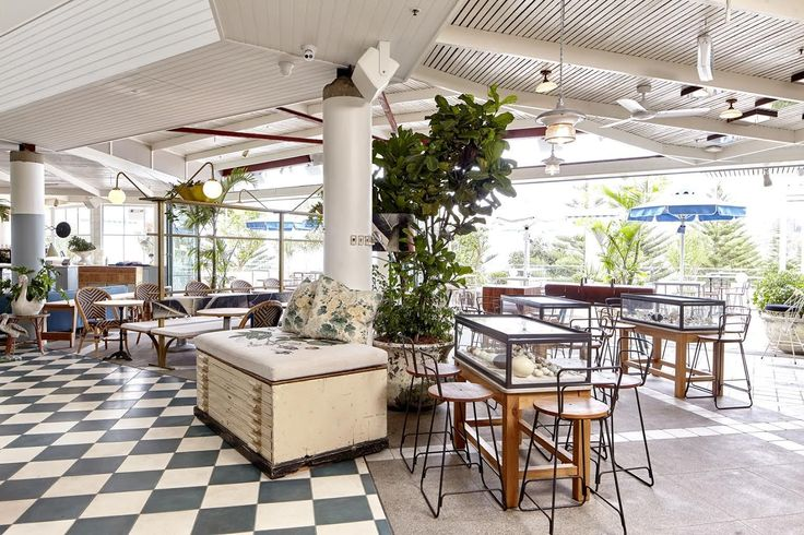 Sydney's Coogee Pavilion - beach cabana-like palette, Muted blues and greens mingle with faded whites, natural woods, and patinaed metals to create an atmosphere that feels like an updated 1960s beach resort.