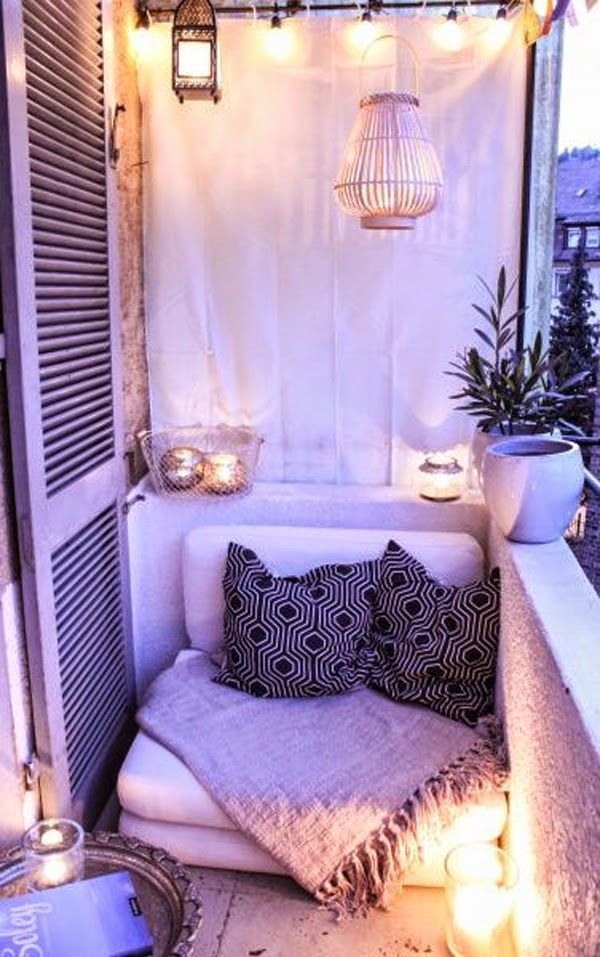 Space shouldn't hinder you from making your balcony comfortable. Throw in a comfortable couch and throw pillows for that homey look. You can even add scented candles in bottles for low light and a home sweet home aroma.