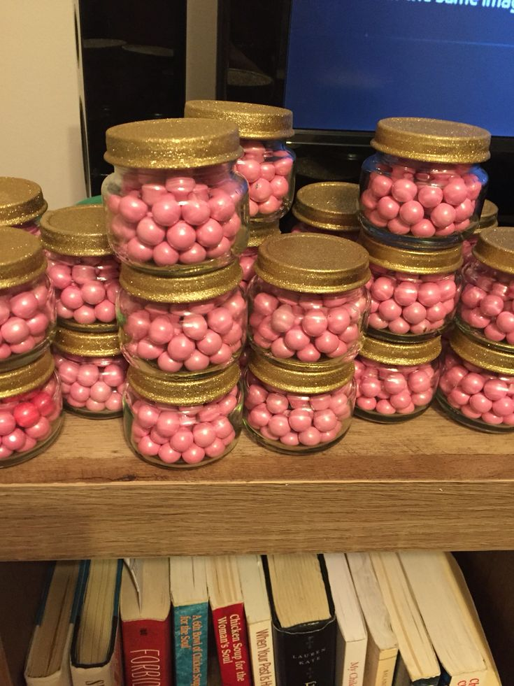 Baby food jars with pink sixlets. Spray paint the lids with Gold glitter paint. Instant and darling Party favors !  Find my craft page on Facebook. Bee Creative Party Supplies !!!