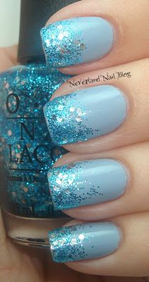 I'M WEARING THE EXACT SAME MANI RIGHT NOW :O I USED OPI ALPINE SNOW (WHITE) INSTEAD OF THE PALE BLUE, BUT I DID A GLITTER TIP GRADIENT WITH GONE GONZO. CRAZY!!!