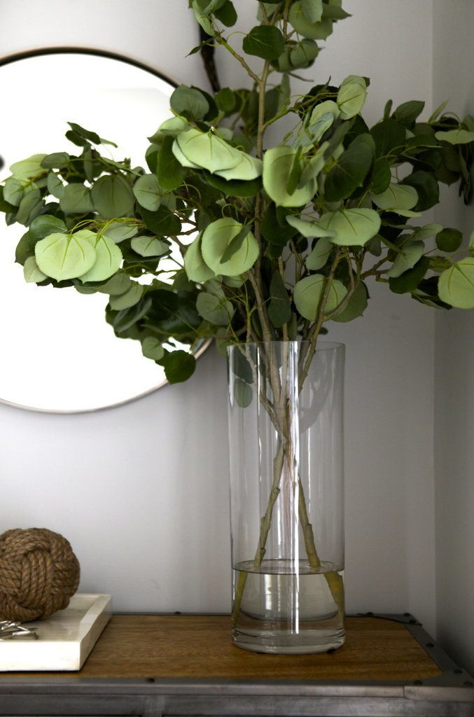 Arrange leafy branches instead of flowers for a clean minimal look