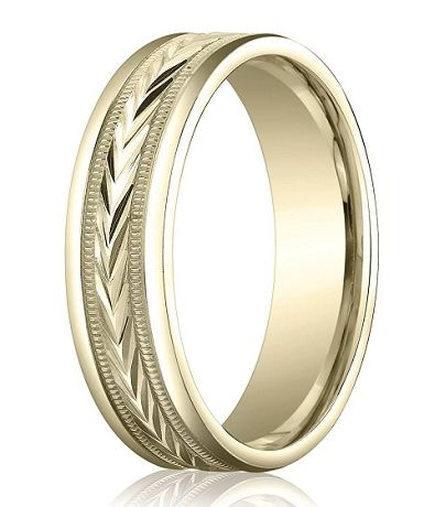 An admirable attention to detail lends this designer gold wedding ring for men an almost antique quality. This 10K yellow gold band features a carved design running down its center, framed by milgrain beading and polished edges. This 6mm comfort fit men's gold wedding band is perfect for the man who appreciates vintage style. Web Page:  http://www.justmensrings.com/Designer-6-mm-Carved-Comfort-fit-10K-Yellow-Gold-Polished-Finish-Wedding-Band--JB1296_p_316.html