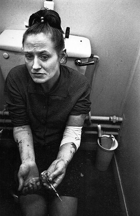 Heroin Addict on the Toilet, London, England, 1969. I wonder if she died or serviced .
