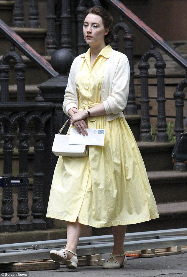 About change: The star later changed into some other clothing for further filming - a lemon yellow dress which she teamed with a cream-coloured cardigan