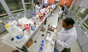 Scientists work on a malaria cure at the University of Cape Town in South Africa, 2012.
