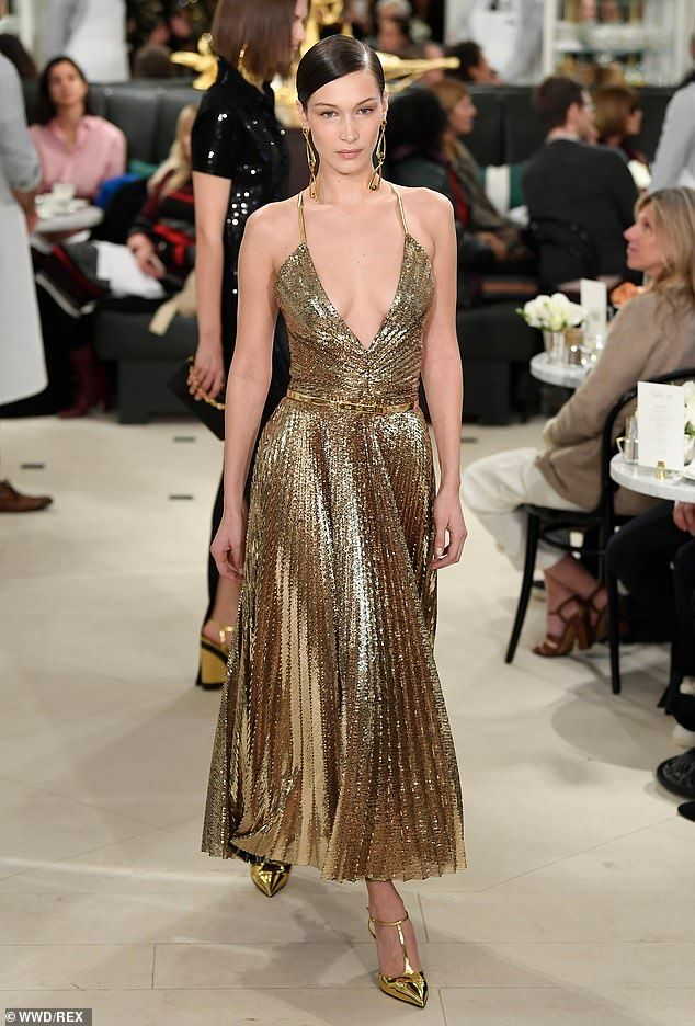 a511f784 Bella Hadid takes the plunge in metallic gold gown at NYC fashion ...