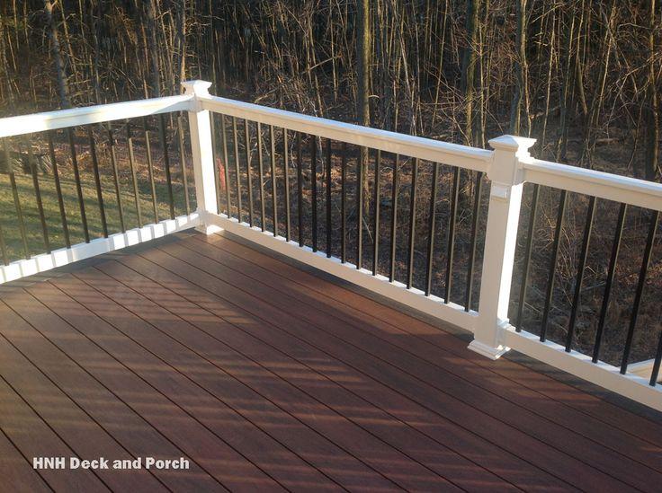 @wolfbuilding  PVC Deck white PVC railing with black square aluminum balusters.