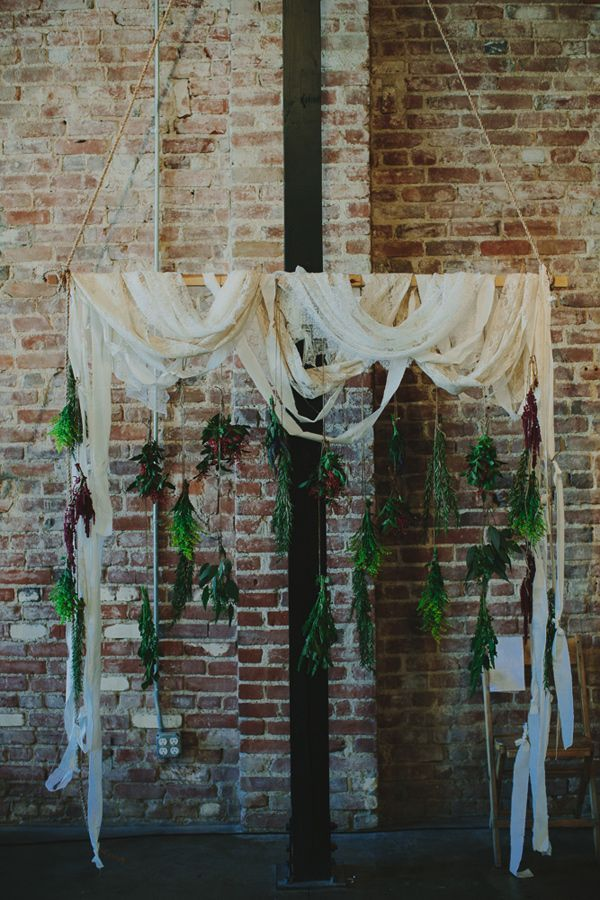 art gallery wedding inspiration | industrial wedding ideas | ceremony backdrop | hanging flowers |