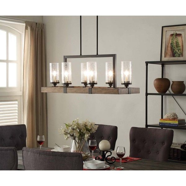 The Vineyard 6-light Metal and Wood Chandelier expands upon our top selling Vineyard lighting collection. The rectangular shaped frame is made of a warm brown wood, and is accented by distressed black