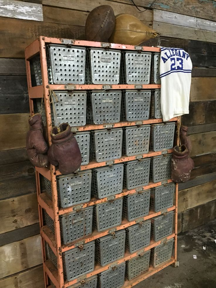 Vintage school gym locker basket units and vintage sports equipment.