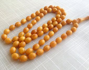 Baltic amber Muslim rosary old antique color Islamic prayer 66 small beads olive shape, imam beads الكهرمان