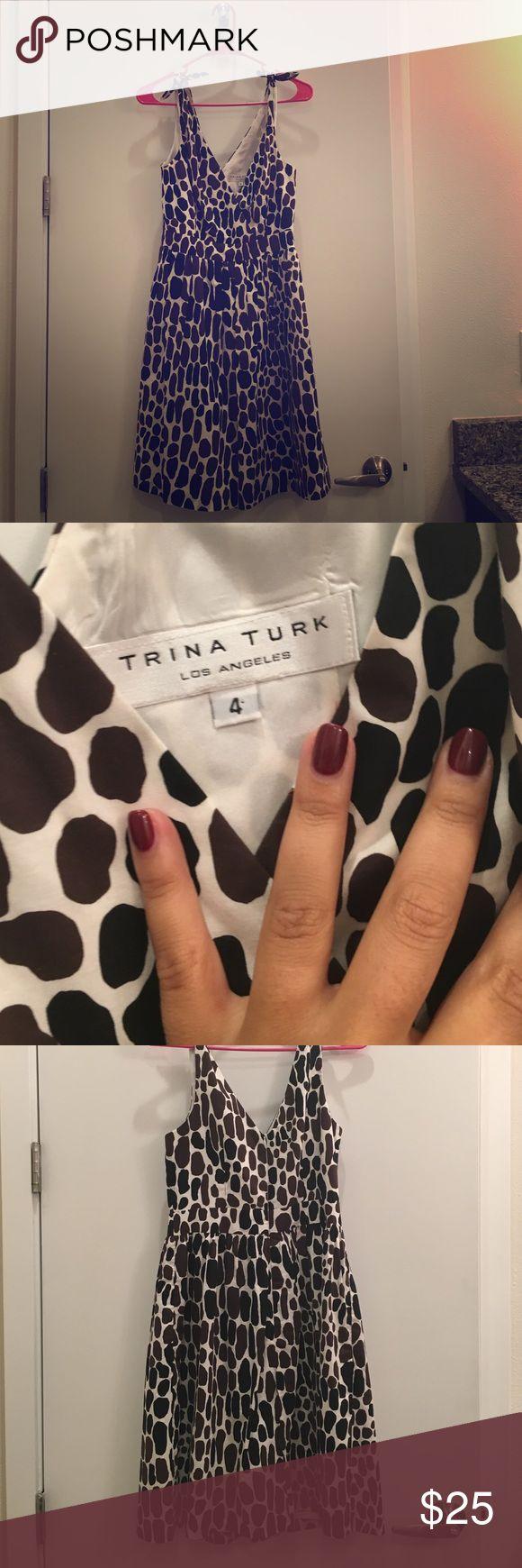 Trina Turk giraffe print dress sz 4 Cute size 4 Trina Turk animal print dress like new ties at the sleeve Trina Turk Dresses Midi