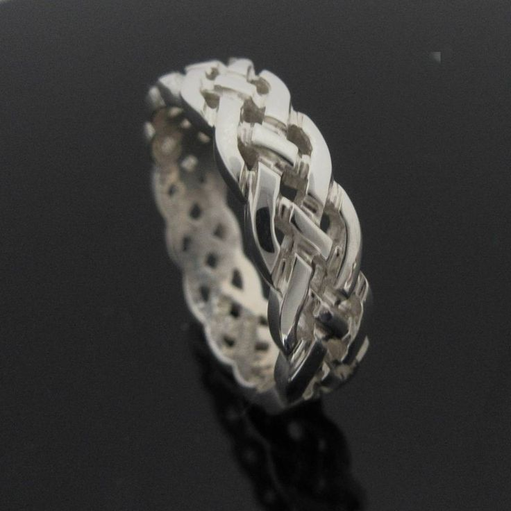 Sterling Silver Celtic Knot band. This beautifully detailed extra heavy is a popular alternative to the traditional wedding ring.
