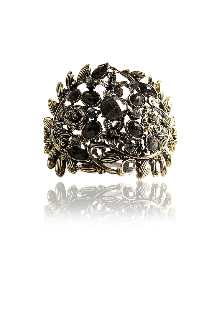 Black flora Ring  •  Flora extravaganza with encrusted crystal  •  Featuring intricate leaf motif design  •  Crafted with black colored jewel cut stones  •  Hinge overlap closure  •  Antique finishing