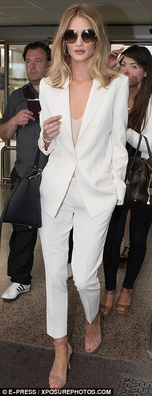 Style, grace and effortless sass: Her fitted trousers allowed the British beauty - engaged to Hollywood actor Jason Statham - to subtly flaunt her lithe legs