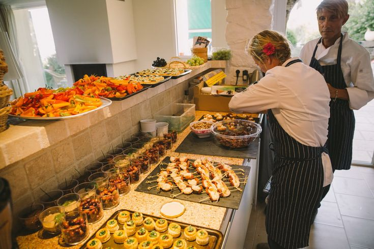 Colorful bell peppers to tarts and ceviches, everything laid neatly in pans ready to be served