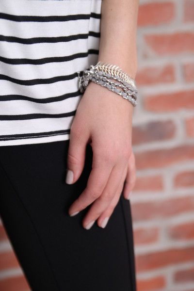 Naima Bracelet Triple wrap suede and sterling silver bracelet. Stunning grey and silver combo. Wear coiled solo or stacked with Ell and Emm's fishbone bracelet (as shown). Tokyo Jane.