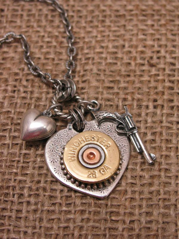Shotgun Casing Jewelry - Shot Through the Heart - Silver Heart Pendant w/ Winchester 28 Gauge Shotgun Shell, Gun & Heart Charm. $48.00, via Etsy.
