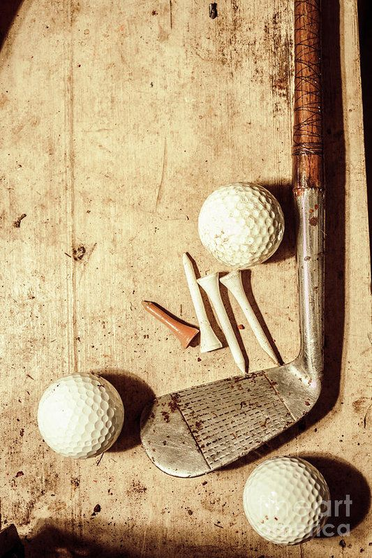 Old fashioned still life shot of a vintage golfing iron with ornate wooden handle coupled with a set of three golf balls and tees on shabby grunge background. Antique sports by Jorgo Photography - Wall Art Gallery