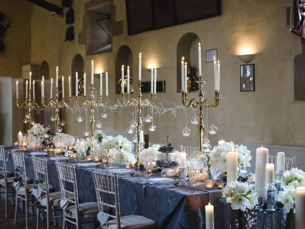 Candelabras, white flowers and metallics create a striking look at Sudeley Castle. © Weddings by Nicola & Glen. #weddingtables #winterwedding #castlewedding #cotswoldwedding #weddingdecor