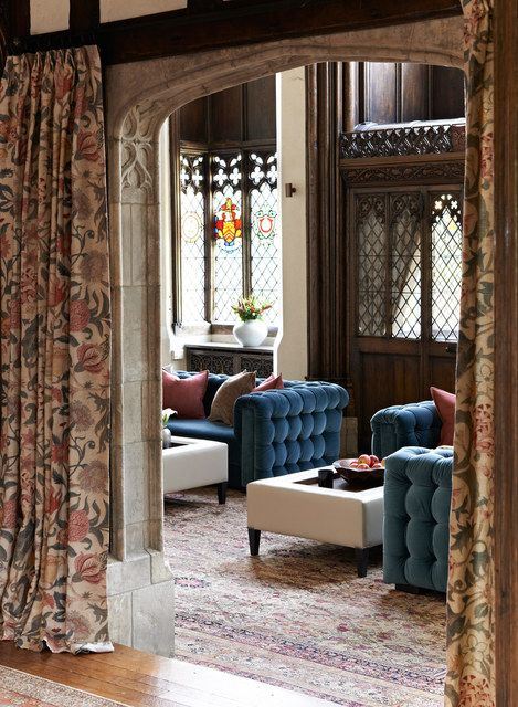 Curtains create a welcoming aspect to the long hallway and soften the look. The curtains can be drawn to close off the great hall and still allow natural light to filter though.