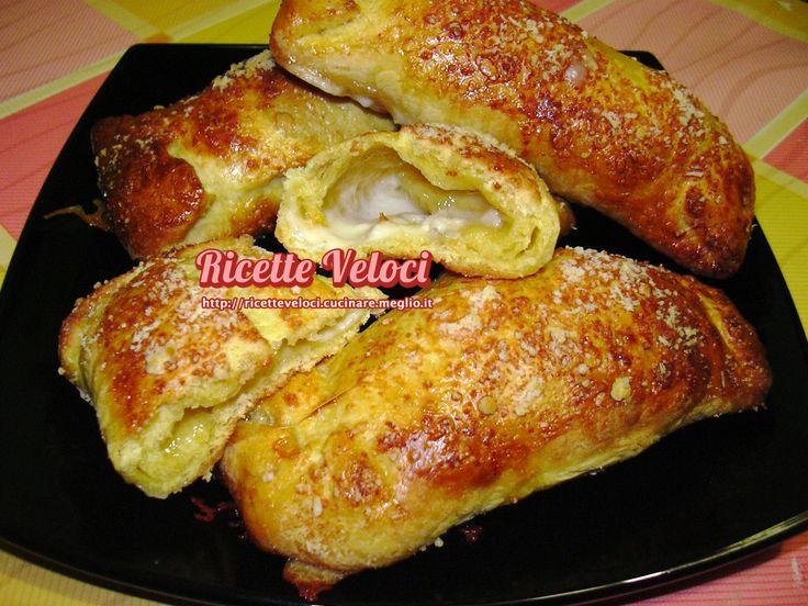 Fagottini allo yogurt ripieni ai formaggix 8 fagottini  Impastare 230 gr di farina manitoba, 1 tuorlo d'uovo, 1 yogurt bianco, 1/2 bustina di lievito di birra secco, 1/2 cucchiaino di sale, 1 cucchiaino raso di zucchero e 40 gr di strutto. Lavorare a lungo l'impasto fino che non sarà liscio e morbido. Dividerlo in 8 parti e mettere a lievitare al caldo per almeno 1 ora, meglio se dentro il forno tiepido spento. Stendere 8 sfogliette rettangolari sottili e mettere al centro 100 gr di…