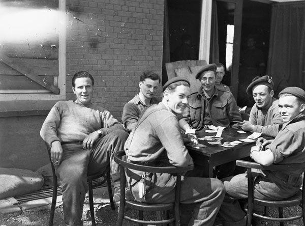 Infantrymen of the 1st Canadian Infantry Division resting after liberating Apeldoorn, Netherlands, 17 April 1945.
