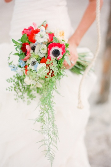 "[""Hearts a Flutter"" wedding invitation inspiration] Bouquet with poppies and ferns, via Southern Weddings Magazine."