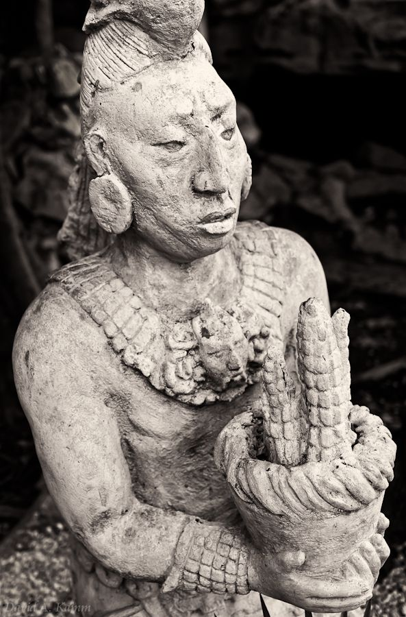 Gifts of the Maya (Mexico) -- Statue of an ancient Mayan presenting a gift of corn. Photographed in the Riviera Maya region of Mexico's Yucatan Peninsula.