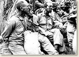 The Bataan Death March, 1942  American prisoners, get a brief rest during the march. - The American and Filipino forces fought  until  surrendering to the Japanese on April 9. The Japanese immediately began to march some 76,000 prisoners (12,000 Americans, the rest Filipinos) north into captivity along a route of death. When 3 American officers escaped a year later, the world learned of the unspeakable atrocities suffered along the 60-mile journey that became known as the Bataan Death March