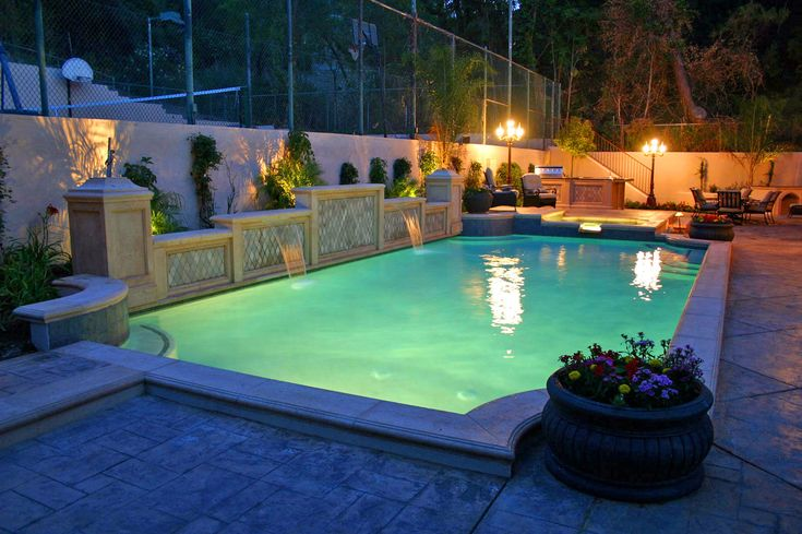Grecian pool and spa with raised bond beam travertine for Raised pool designs