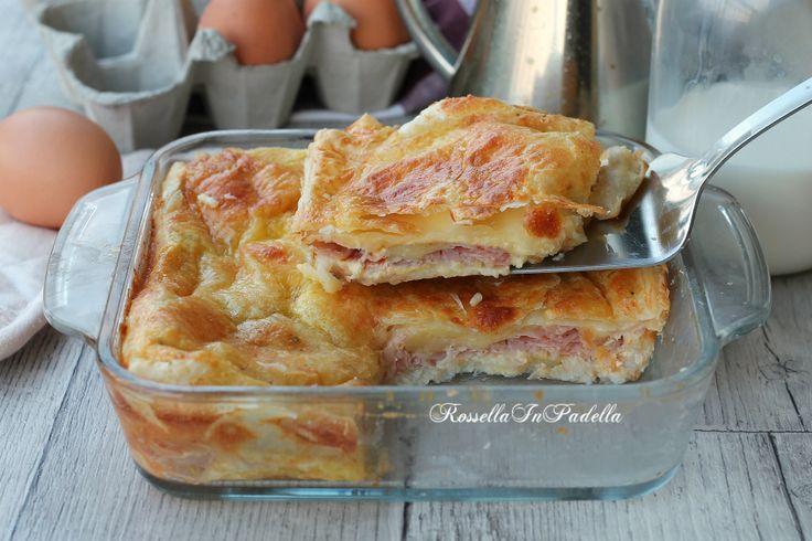 Torta al prosciutto velocissima, gustosa torta salata con una base di pane per tramezzini, un gustoso ripieno di prosciutto e ricoperta di pasta sfoglia.