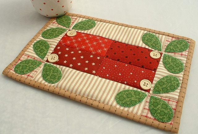 I like these colors together.  Leaves could also work for general garden theme - - - Mistletoe Mug Rug | Flickr - Photo Sharing!