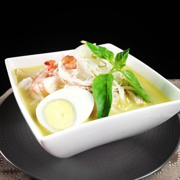 Laksa Bogor is one of the most famous food in Indonesia. The thick yellowish coconut milk based soup is a mixture of shallot, garlic, kemiri, kunyit, ketumbar, sereh & salt. The hot soup runs, drained, and filled several times into the bowl contains bihun, ketupat, smashed oncom, tauge, kemangi (lemon basil leafes), cooked shredded chicken and prawn, boiled egg, until all the ingredients is soft and cooked. Usually Laksa Bogor is served with sambal cuka (grinded chilli in vinegar).