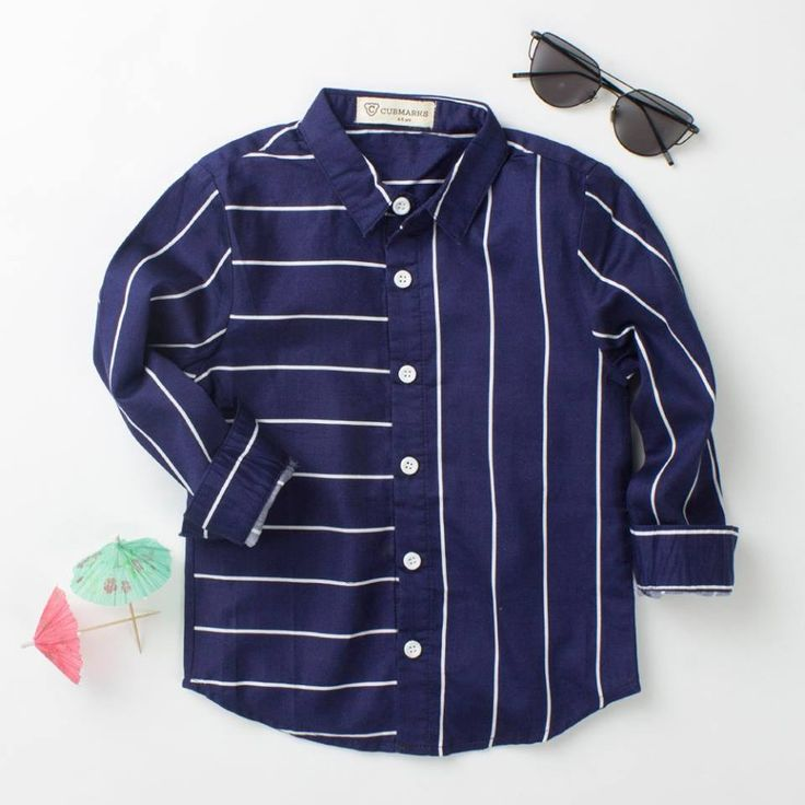 Great combination of horizontal and vertical stripes in a navy blue color buttoned down ,long sleeved shirt ,which can brighten up the look of your boys at the occasion. #casualshirtsforkids #boyscollection #boyssummercollection #blue #shirt #CV #Curiousvillage