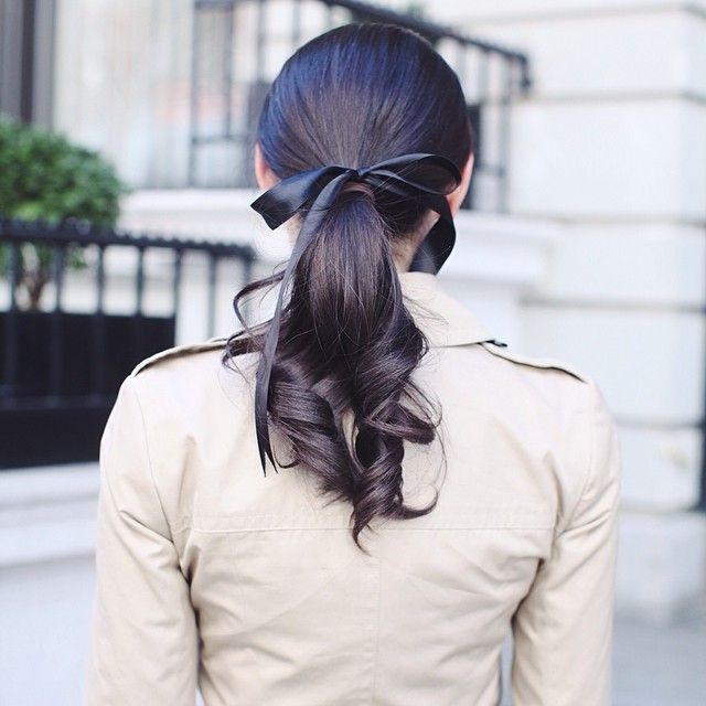 a bows, ponytail, and trench