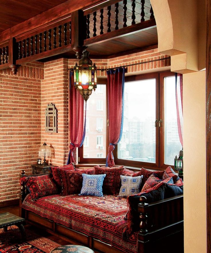 amusing orienta style with brick wall plus classic chandelier and sofa beside bay window also dark wodoen ceiling