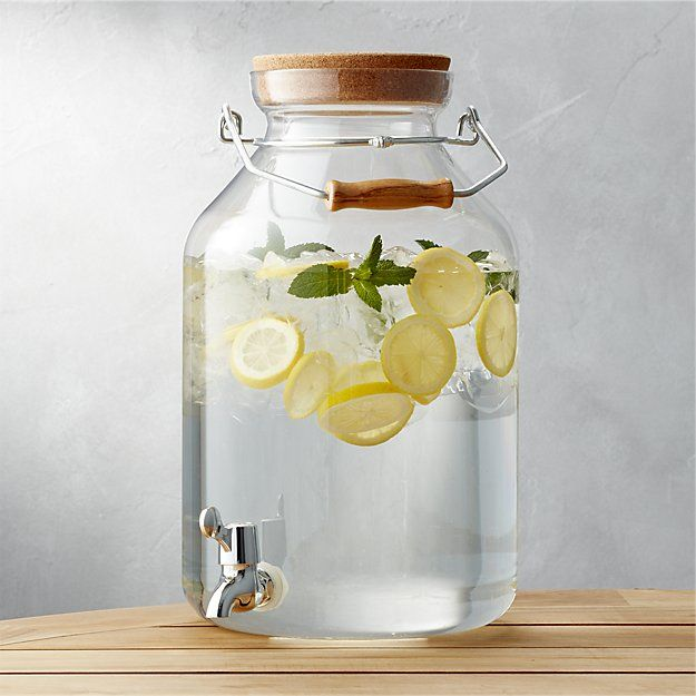 Large-capacity dispenser pours on the fun at casual cocktail parties, family reunions and outdoor occasions. Clear acrylic container is topped with a cork lid and gets a lift from its metal and wood handle. Low-lying spout ensures easy and long-lasting pouring.