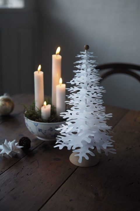 Advent decoration with four candles and paper art decorations Christmas trees