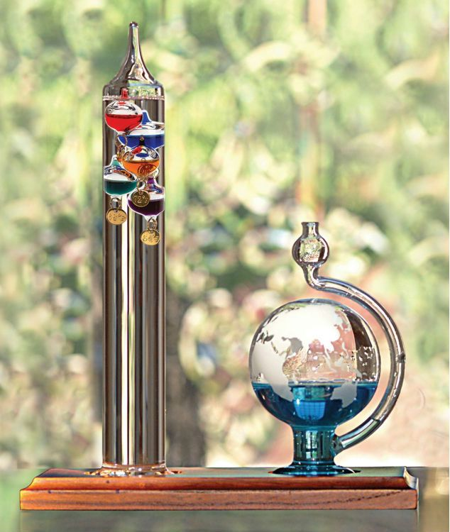 Galileo Thermometer with Glass Globe Barometer: This handsome unit uses a blend of old and new technology to interpret the weather. The Galileo thermometer is filled with a clear liquid that suspends multiple colored weights. As the liquid within the weights changes temperature their density ...Read More @ http://greateststuffonearth.com/galileo-thermometer-with-glass-globe-barometer/