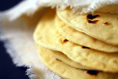 *Texas* Flour Tortillas (adapted from The Border Cookbook by Cheryl Alters Jamison and Bill Jamison) Ingredients: Two cups of all-purpose flour (can make them whole wheat by substituting one cup of whole-wheat flour for white flour) 1 1/2 teaspoons of baking powder 1 teaspoon of salt 2 teaspoons of vegetable oil 3/4 cups of warm milk <3~<3 then you smear with butter and life is GOOD! Homesicktexan.com