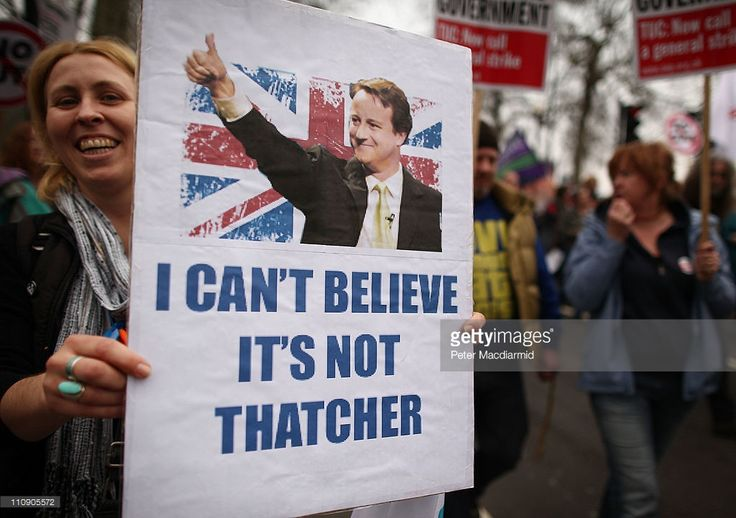 A woman holds a placard depicting British Prime Minister David Cameron as she marches in protest at government cuts on March 26, 2011 in London, England. Thousands are taking part in the Trades Union Congress (TUC) organised march to Hyde Park where a rally will take place. Police say they are deploying 4500 officers.